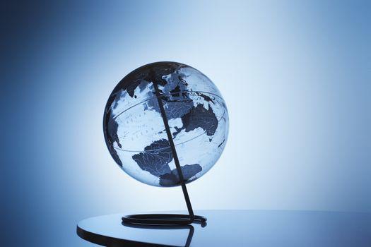 Transparent globe on stand in studio