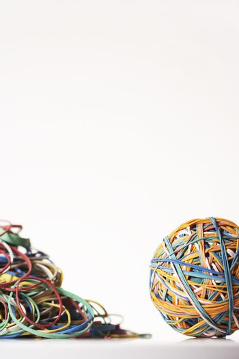 Rubber Band Ball by pile of rubber bands in studio