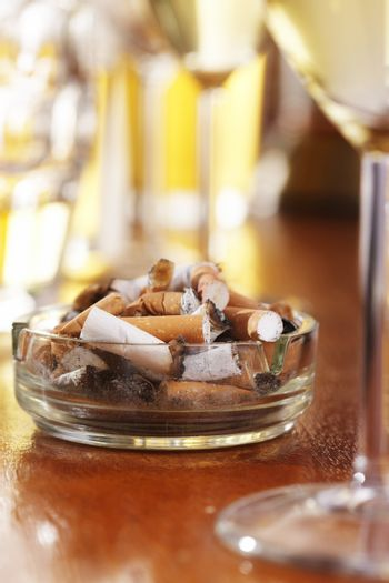 Cigarettes in ashtray at cafe
