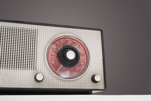 Closeup of retro radio isolated over colored background