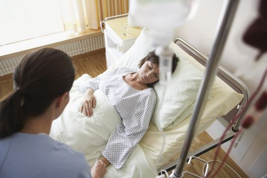 Elevated view of a nurse With patient in hospital room