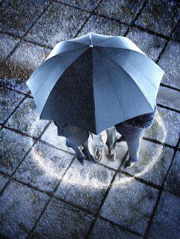 Elevated view of three businesspeople hidden under one umbrella