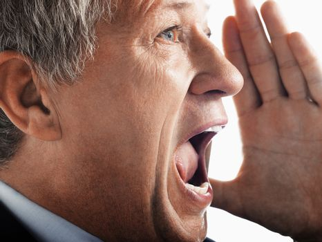 Closeup of an angry businessman screaming out loud