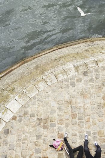 Elevated view of a cropped couple relaxing by the canal