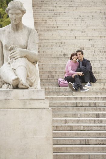 Portrait of a happy young couple sightseeing on steps