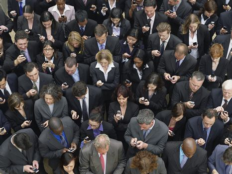 Large group of business people text messaging elevated view