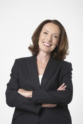 Smiling Businesswoman standing with arms crossed