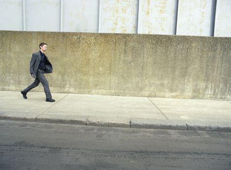 Full length of business man walking on sidewalk