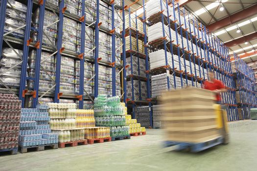 Blurred forklift driver warehouse