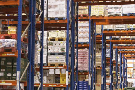 View of shelves in warehouse full of merchandise