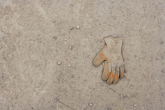 Work Glove Lying In Dirt