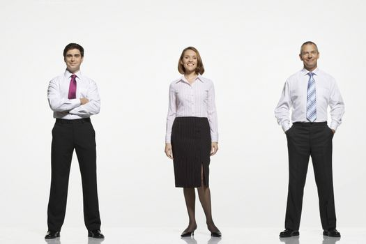 Full length portrait of businesspeople standing side by side against white background