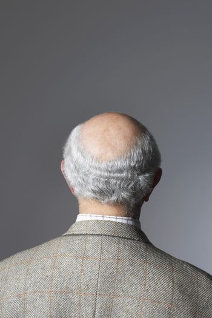 Senior Man in studio head and shoulders back view