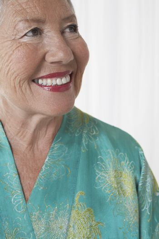 Senior woman in dressing gown in studio head and shoulders