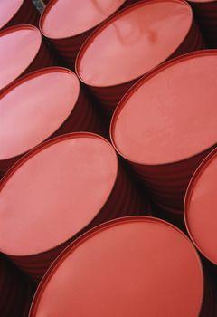 Series of red-painted metal drums