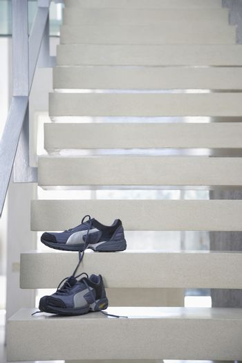 Pair of athletic shoes on steps