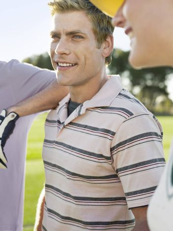 Male Golfer With Friends