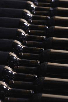 Full frame shot of bottles arranged in wine cellar