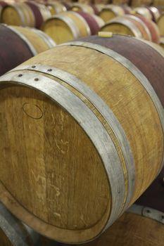 Full frame shot of wine casks in cellar