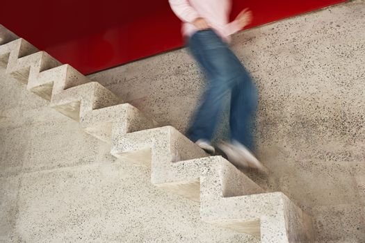 Low section of a man running down stairs