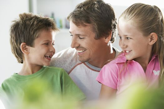 Father With Children Smiling At Home