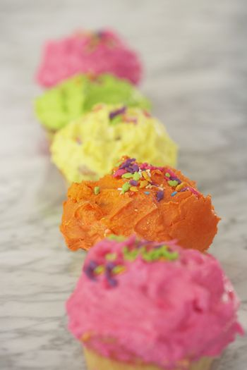 Row of cupcakes on kitchen surface