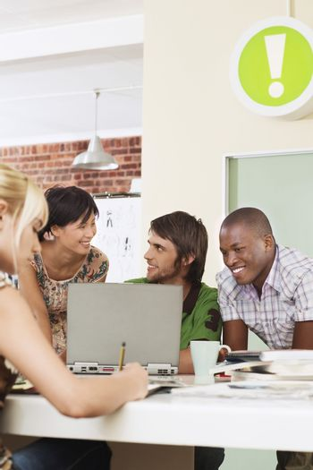 Group of multiethnic business people using laptop in meeting room