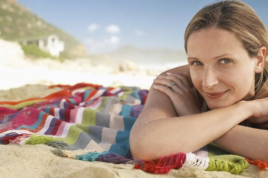Woman lying on beach portrait