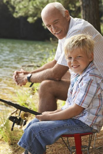 Portrait of Grandfather and Grandson Fishing together