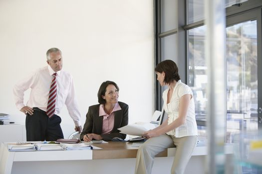 Three business people having a meeting in office