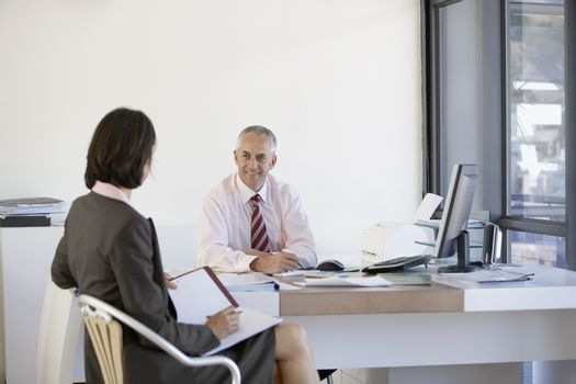 Two business people having a meeting in office