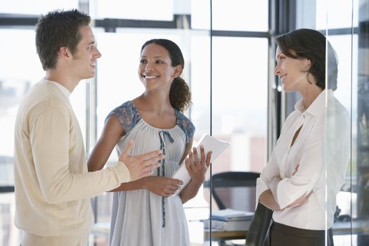 Multi ethnic business people communicating in office