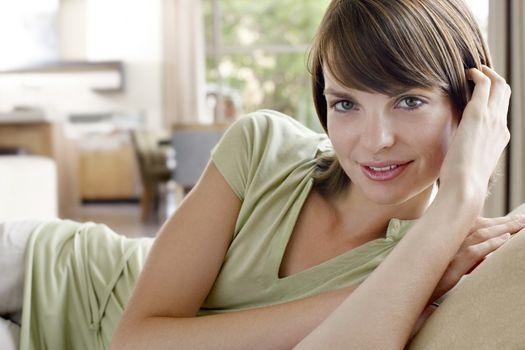 Woman resting on sofa portrait
