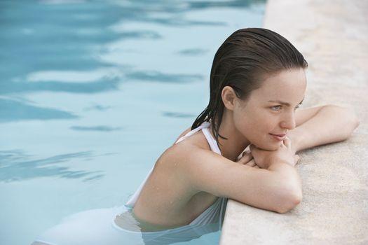 Women resting in swimming pool