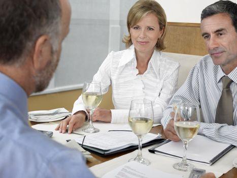 Businesspeople having meeting in restaurant