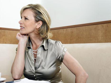 Beautiful Caucasian businesswoman in restaurant