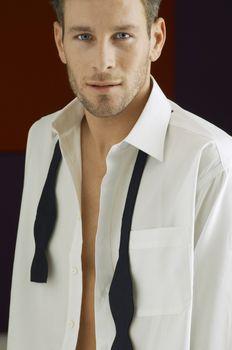 Portrait of a smart Caucasian man wearing unbuttoned shirt