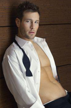 Portrait of a smart man wearing unbuttoned shirt
