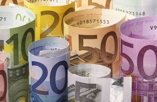 Rolled up Euro banknotes