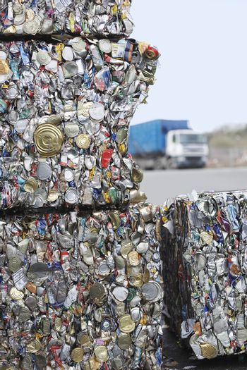 Stakes of crushed tin cans for recycling
