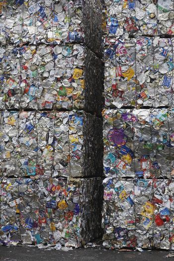 Stakes of compacted garbage at recycling plant