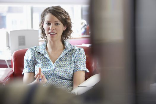 Young businesswoman and man in a meeting at office