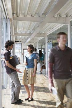 Office colleagues standing in corridor
