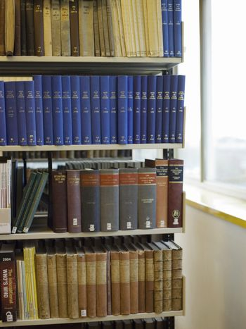 Closeup of books on shelf in the library