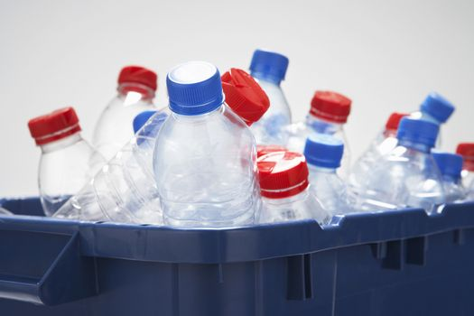 Container filled with empty plastic bottles close-up
