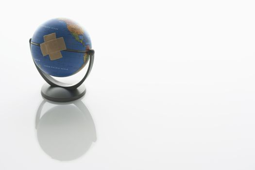 Globe With Adhesive Plaster
