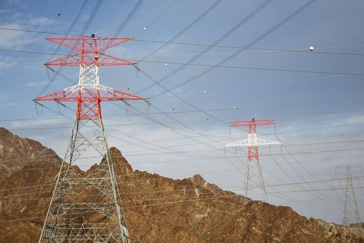 Electricity pylons in mountain landscape