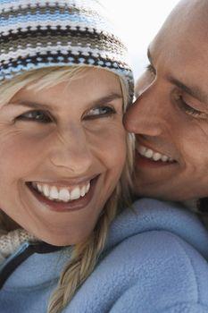Couple embracing on mountain peak close-up portrait