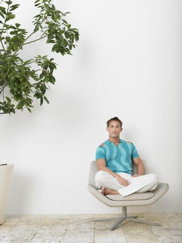 Man Sitting in Swivel Chair
