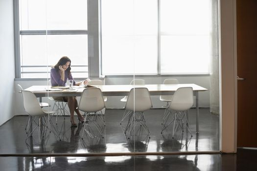 Young businesswoman sitting in conference room